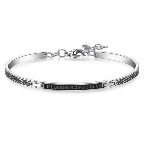 """316L polished stainless steel semi-rigid bracelet, with black nail and """"Life begins each morning"""" lettering."""