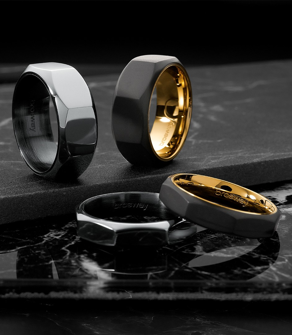 doha rings and earrings on a black marble